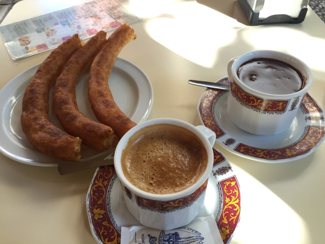 Churros, chocolate, and coffee = breakfast of champs. Granada